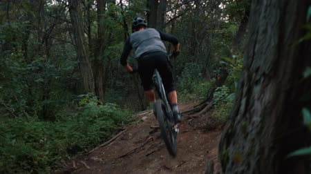 enduro : extreme bicyclist rides on forest path, slow motion