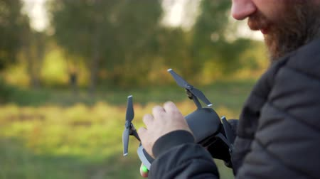propeller toy : man calibrates in hands quadrocopter before flight
