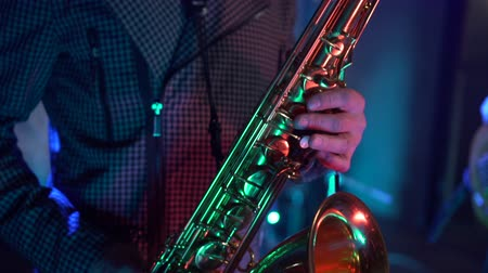 jazzman : male hands playing saxophone in nightclub, close-up Stock Footage