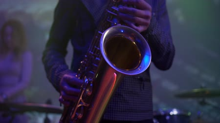 jazz festival : male hands playing saxophone in nightclub, close-up Stock Footage
