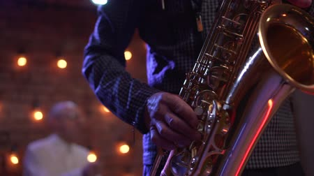 saxofone : male hands playing saxophone in nightclub, close-up Stock Footage