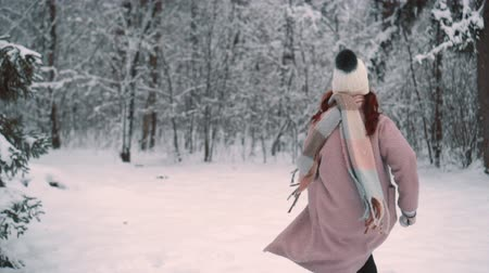 joyfulness : woman runs effortlessly in snow-covered park