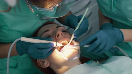 salya : Ultrasonic cleaning of teeth. Removal of solid teeth.