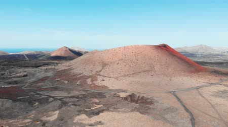 lifeless : Approaching in air to large crater on Lanzarote Island, Canaries