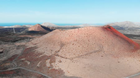 lifeless : Top view of large crater of extinct volcano, Lanzarote, Canaries Stock Footage