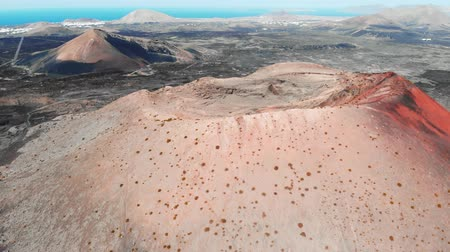 extinto : Top view of large crater of extinct volcano, Lanzarote, Canaries Stock Footage