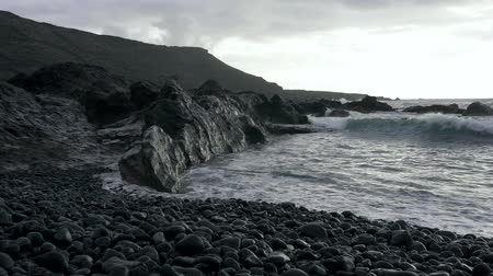 хмурый : Rocky black coast of volcanic island
