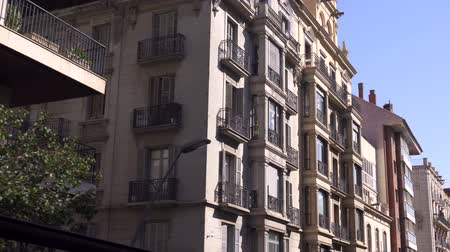 BARCELONA, SPAIN - FEBRUARY 19, 2019: view of facades of buildings on streets of city Stock Footage
