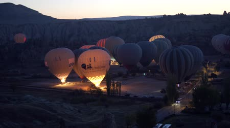 GOREME, TURKEY - NOVEMBER 1, 2018: hot balloons are preparing to fly before dawn