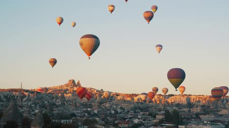 GOREME, TURKEY - NOVEMBER 1, 2018: colorful hot balloons fly over city 動画素材