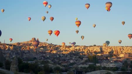 GOREME, TURKEY - NOVEMBER 1, 2018: colorful hot balloons fly over city Stock Footage