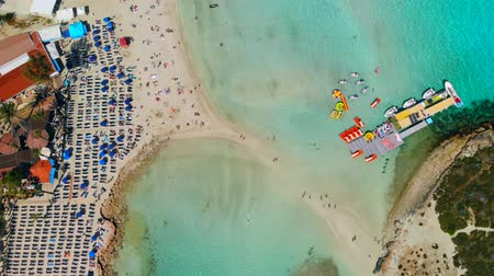 kypr : Aerial view of beautiful Nissi beach in Ayia Napa, Drone flies over beach with lot of tourists