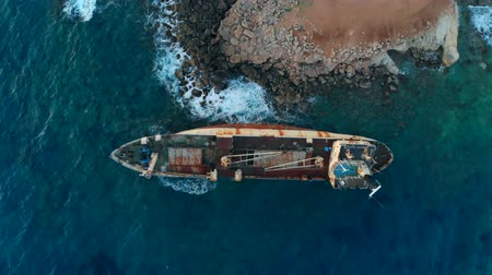 freighter : Abandoned boat stranded on shore of Mediterranean Sea, top view