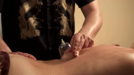 healer : Young woman on procedure of vacuum cupping massage, close up