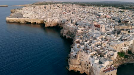 zeepaard : Flying over rooftops of Italian city of Polignano a Mare at sunset, Apulia Stockvideo