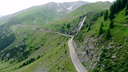 yılantaşı : Flight over road among high mountains of Transylvania, cloudy day Stok Video