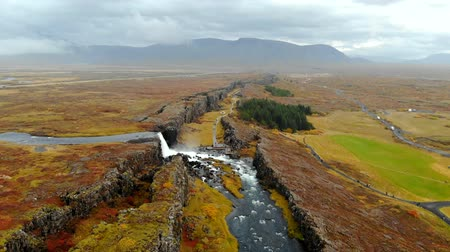 nordic countries : Aerial view autumn landscape in Iceland, rocky canyon with waterfall, Thingvellir