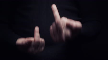 kaba : A man makes an obscene gesture showing the middle finger, close-up on a black background Stok Video