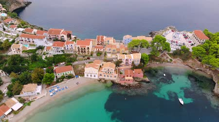 yarımada : A drone flies back showing a panorama over the beautiful city of Asos on Kefalonia, Greece