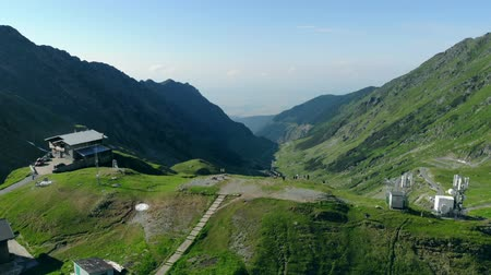 hegytömb : A drone rises above the highest point of the Transfagaras mountain road showing a panoramic view of the valley