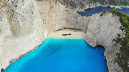 zakynthos : Top down aerial view of a beautiful Navagio beach in the Ionian Sea on the shore of Zakynthos island, Greece Stock Footage