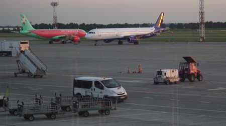 ranvej : BORISPOL, UKRAINE - JUNE 2019: Attendants arrived at work on the airport runway