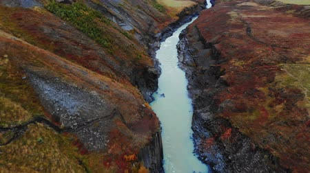 esplêndido : Aerial view of Studlagil Canyon, Jokulsa A Bru river in Iceland, drone shot