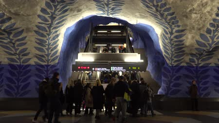 İsveççe : STOCKHOLM, SWEDEN - DECEMBER 4, 2019: People on the station T-Centralen of Stockholm. Passengers rise on the escalator. Stok Video