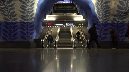 stockholm : STOCKHOLM, SWEDEN - DECEMBER 4, 2019: People on the station T-Centralen of Stockholm. View of the escalator. Stock Footage