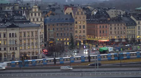 STOCKHOLM, SWEDEN - DECEMBER 4, 2019: A subway train passes on the background of the historical part of the city of Gamla Stan. 動画素材
