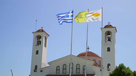 greek flag : Flags of Cyprus and Greece fluttering in the wind against the background of the church. Slow motion.
