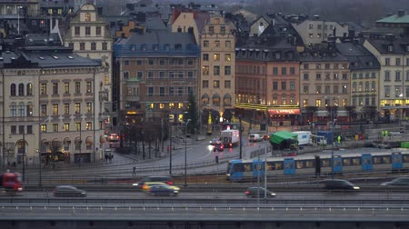 STOCKHOLM, SWEDEN - DECEMBER 4, 2019: A subway train passes on the background of the historical part of the city of Gamla Stan. Stock Footage