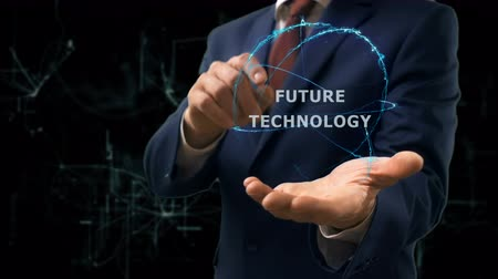visão global : Businessman shows concept hologram Future technology on his hand. Man in business suit with future technology screen and modern cosmic background Vídeos