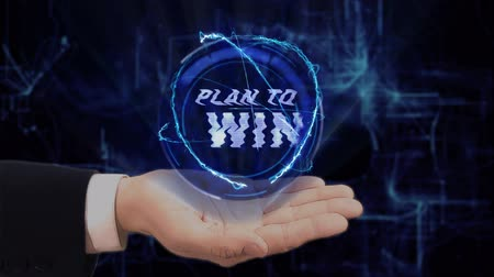motivasyonel : Painted hand shows concept hologram Plan to win on his hand. Drawn man in business suit with future technology screen and modern cosmic background Stok Video