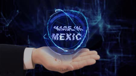fabricated : Painted hand shows concept hologram Made in Mexico on his hand. Drawn man in business suit with future technology screen and modern cosmic background