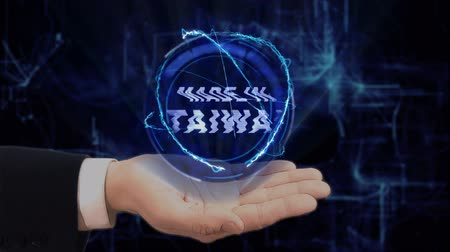 coisa : Painted hand shows concept hologram Made in Taiwan on his hand. Drawn man in business suit with future technology screen and modern cosmic background Vídeos