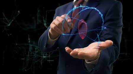 kardiolog : Businessman shows concept hologram Heart on his hand. Man in business suit with future technology screen and modern cosmic background