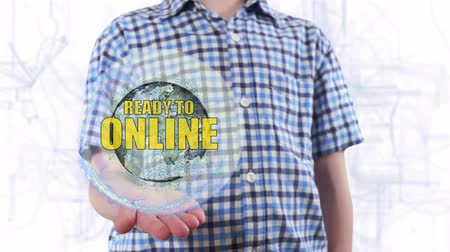 přihrádka : Young man shows a hologram of the planet Earth and text Ready to online. Boy with future technology 3d projection on a modern white digital background