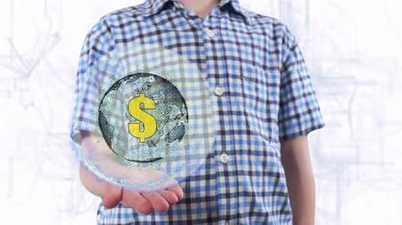 поколение : Young man shows a hologram of the planet Earth and Sign USD. Boy with future technology 3d projection on a modern white digital background