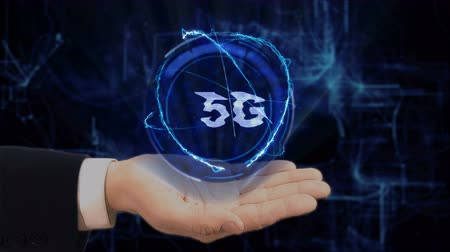 standardization : Painted hand shows concept hologram 5G on his hand. Drawn man in business suit with future technology screen and modern cosmic background