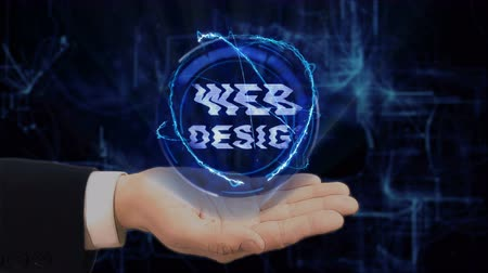 devise : Painted hand shows concept hologram Web Design on his hand. Drawn man in business suit with future technology screen and modern cosmic background Stock Footage