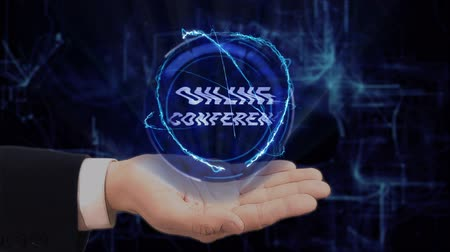 conferencing : Painted hand shows concept hologram Online conference on his hand. Drawn man in business suit with future technology screen and modern cosmic background Stock Footage