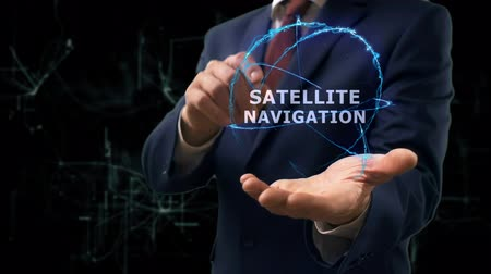 navigator : Businessman shows concept hologram Satellite navigation on his hand. Man in business suit with future technology screen and modern cosmic background