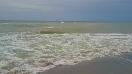 dirty beach : Dirty or muddy sea during windy weather. Waves on the beach look like sewage