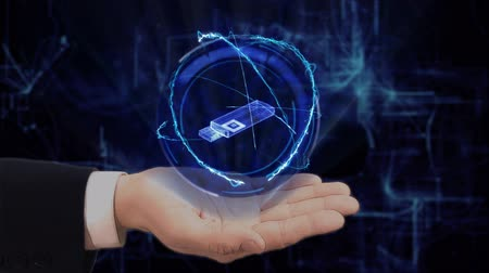 removable : Painted hand shows concept hologram 3d USB stick on his hand. Drawn man in business suit with future technology screen and modern cosmic background Stock Footage