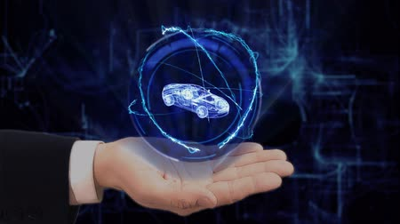 разведка : Painted hand shows concept hologram 3d sport car on his hand. Drawn man in business suit with future technology screen and modern cosmic background