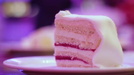 baked pudding : Appetizing piece of cake on a plate. Birthday celebration, delicious and juicy cake close up Stock Footage