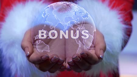 Female hands holding a conceptual hologram of planet Earth with text Bonus. Woman in red clothes with faux white fur with future holographic technology