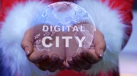 irreconhecível : Female hands holding a conceptual hologram of planet Earth with text Digital city. Woman in red clothes with faux white fur with future holographic technology