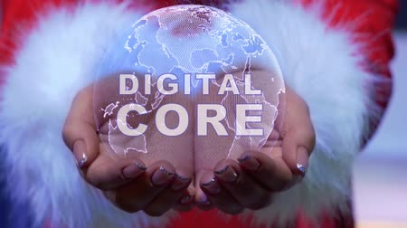 digital code : Female hands holding a conceptual hologram of planet Earth with text Digital Core. Woman in red clothes with faux white fur with future holographic technology Stock Footage